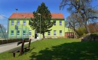 Víceúčelová budova u kostela zázemím i pro knihovnu